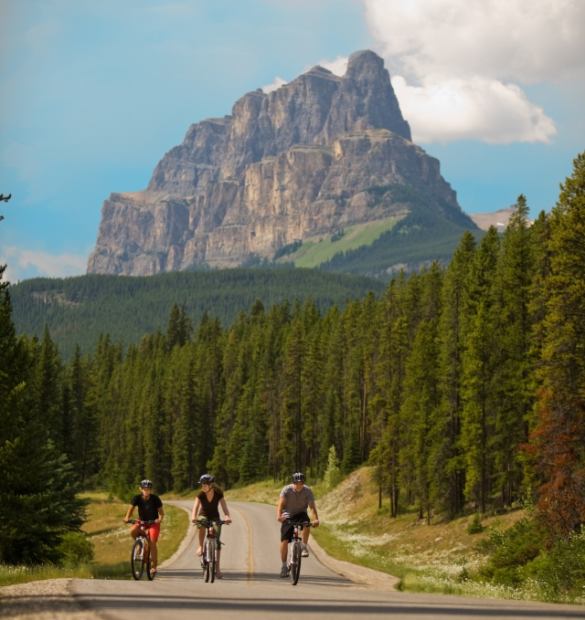 Cycling on Bow Valley Parkway in Banff Naitonal Park, Alberta, Canada.